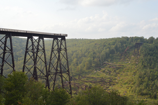 Kinzua Bridge used to be a railway trestle. Now abandoned, it has collapsed, and no one has bothered to fix it. It rests starkly against the surrounding landscape.