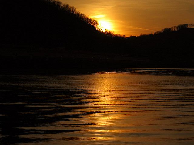 11. The setting sun reflects onto the confluence of the Ohio, Monongahela, and Allegheny Rivers in Pittsburgh.