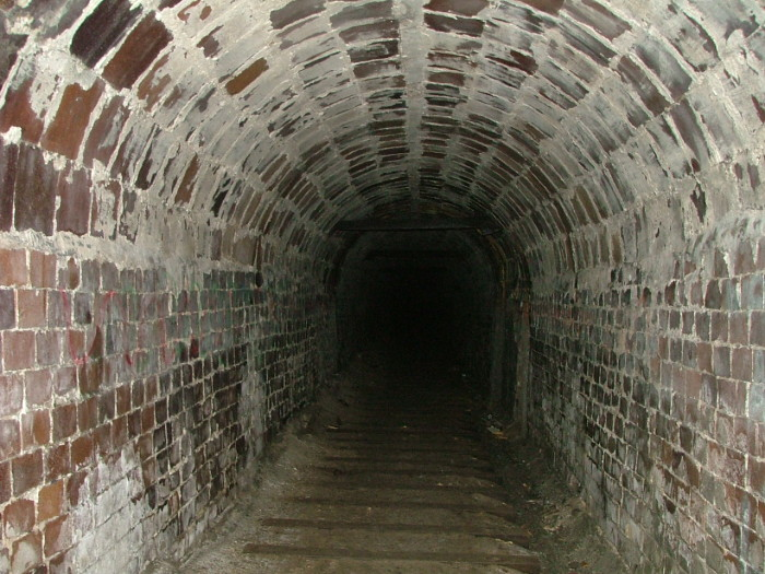 12) Haydenville Tunnel: This eerie tunnel stretches for nearly a mile between a sealed-off mine and a long-demolished manufacturing plant in Hocking County.