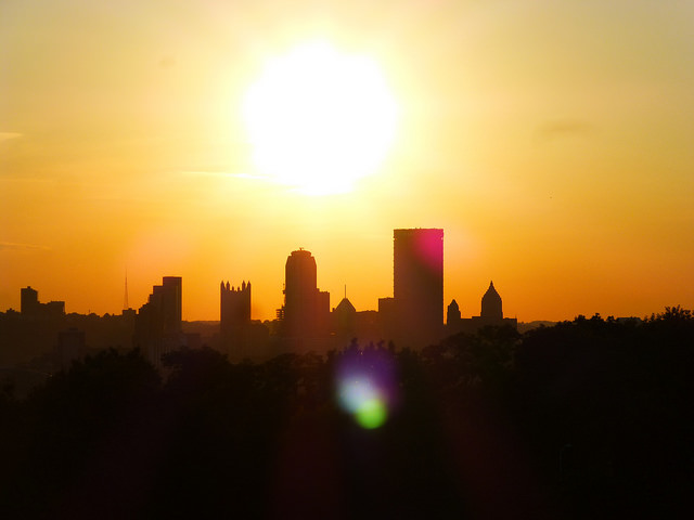 19. The entire sky is illuminated by the setting sun behind the Pittsburgh skyline.