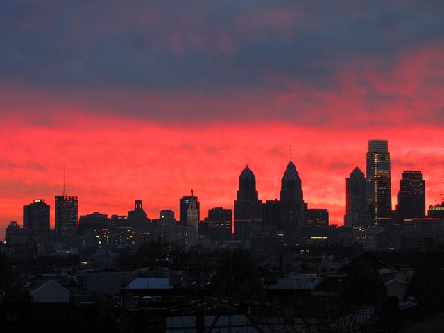 25. The Philadelphia skyline stands tall against a fuchsia sky.