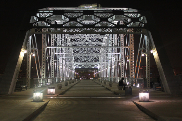 Nashville is ringed by the Cumberland River and hemmed in by a series of bridges, the Pedestrian Bridge being the most popular for travel by foot. Take a walk across at night holding hands and finish the evening on Broadway.