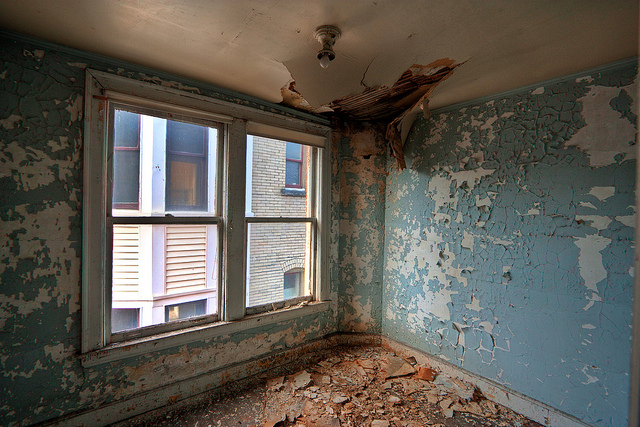 13) A vacant room with creepy peeling paint in the Fort Henry Club, located in Wheeling, West Virginia.