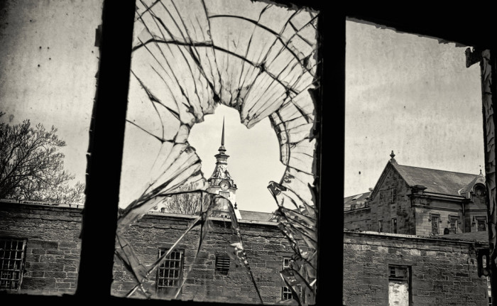 Looking through this broken window to the clock tower is actually quite stunning, but oh-so unsettling.