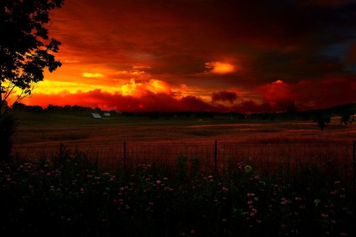 11) A magnificent sunset taking place at an unnamed farm somewhere in the beautiful mountain state.