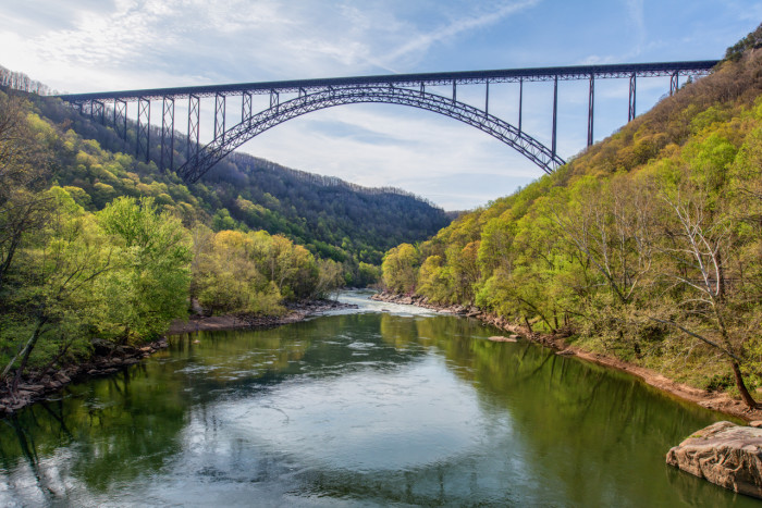 """The New River Gorge Bridge is one of the highest vehicular bridges in the world. If you are courageous enough, visit this bridge in late October for """"Bridge Day,"""" where people willingly jump off of the bridge for fun. You certainly won't see me there."""