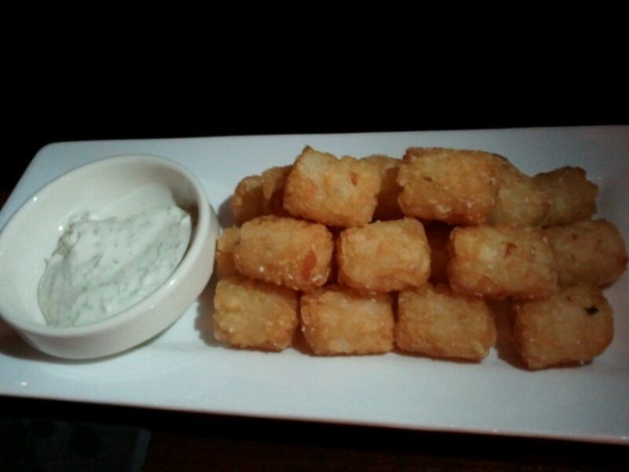 3) Patterson House is a mid-Nashville based bar that is a dim-lighted speakeasy, a hidden gem that boasts specialty cocktails and an hour-long wait time that's worth every minute. Also? Their fantastic tater-tots are to die for.