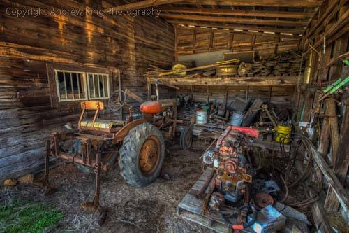 2. Rusting tools and equipment once ensured the livelihood of a family, now this abandoned barn rests peacefully in Wilson County.