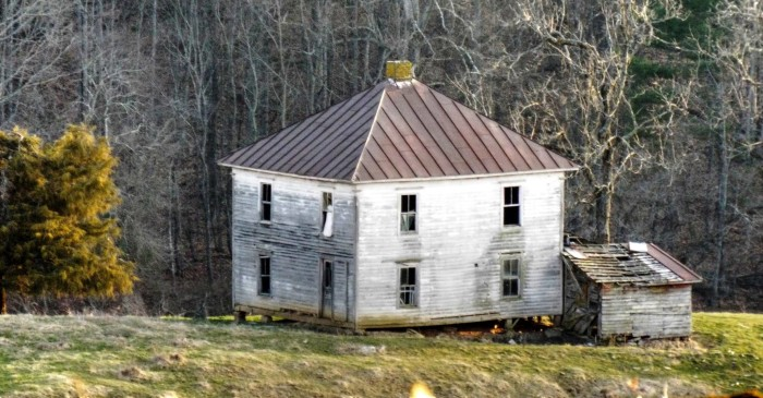 7. An interesting little white house seems to almost shy away from the camera, sitting silently at the base of a hill in Alleghany County