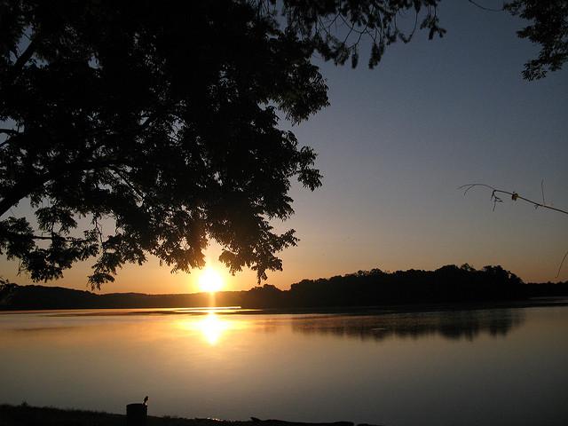 8. The rising sun leaks into Lake Ontelaunee.