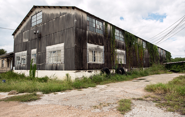 14) A decaying warehouse in Texas once bustling with workers now lies in quiet abandon.