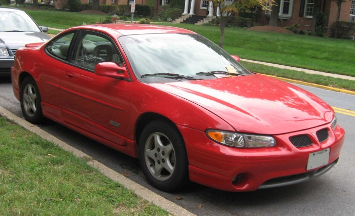 17. They're driving an immaculately kept Pontiac Grand Prix.