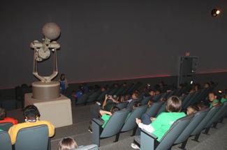 21. Kiss beneath the 'digital' stars at SciWorks Planetarium.