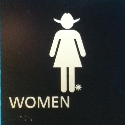 15) A true Texas-themed bathroom sign.