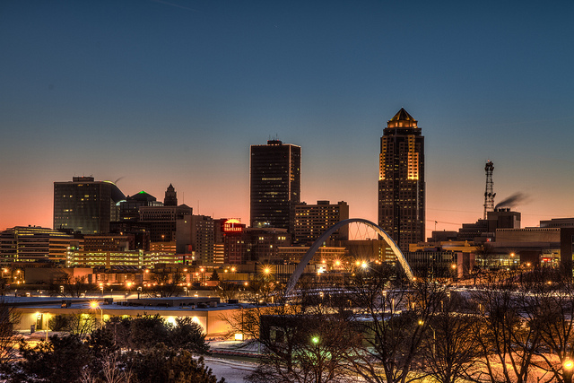 10. A fading sun sinks behind the city of Des Moines.