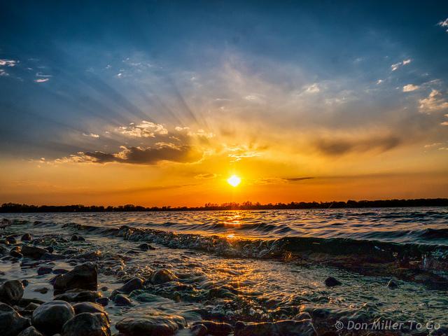 12. A  dazzling sun reflecting off Lake Okoboji.