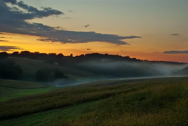 13. Fog rolling through the valley during an enchanting sundown.