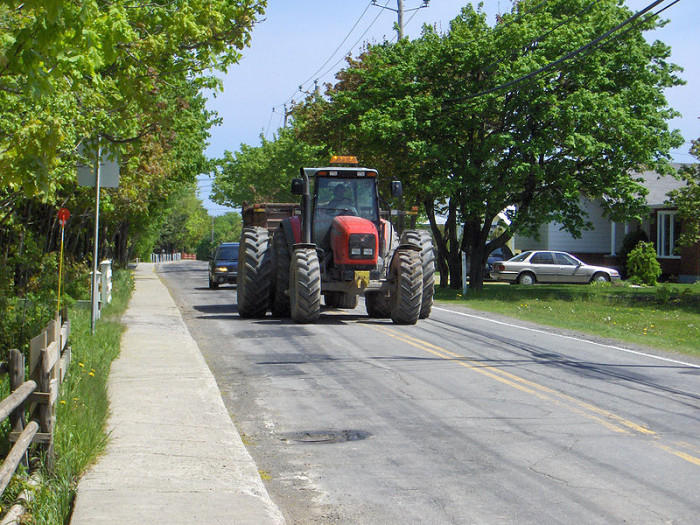 2.) You consider 8 vehicles waiting for a tractor to drive across the road to be a horrible traffic jam.