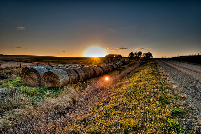 2. A stunning sundown over a rural field.