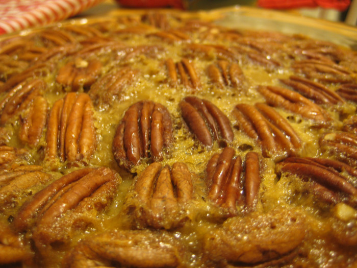 19. Pecan PIe is happiness to the tastebuds, just not the waistline! Some make them thin, some thick, some make them with chocolate, and some make them with a caramel. I like mine traditional and thick with ooey-gooey syrup and pecans!