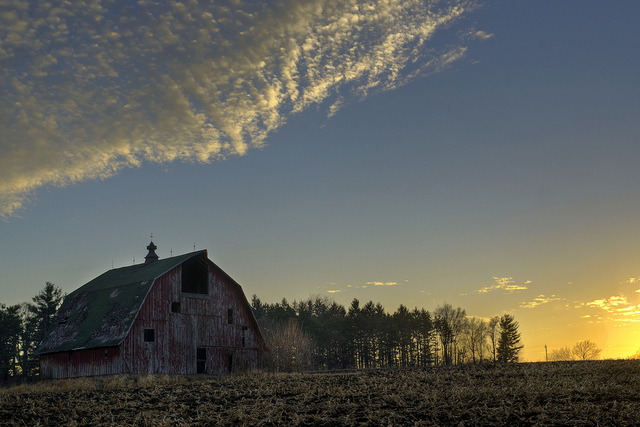 5. This seasoned old barn in Bertram, Iowa watches over a sunset field.