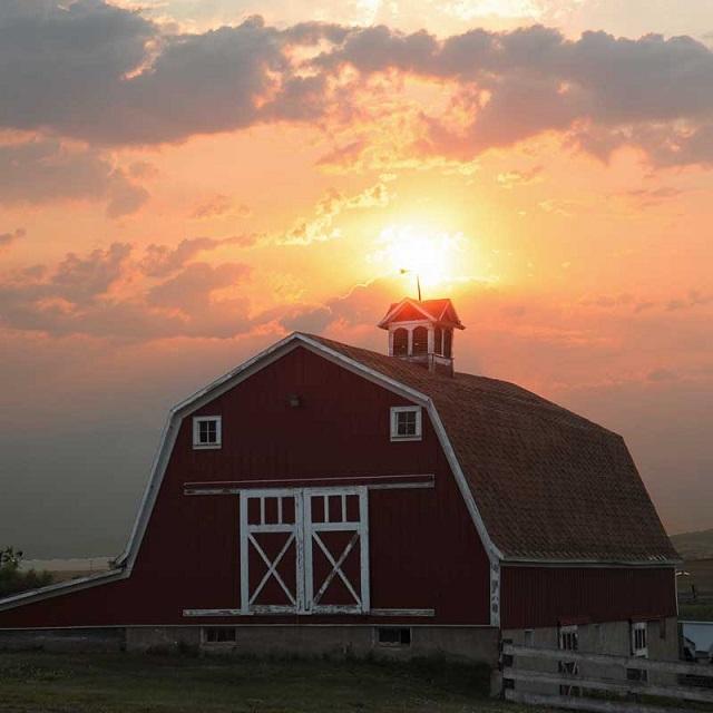 15. A sunrise over a barn in Richardton, North Dakota