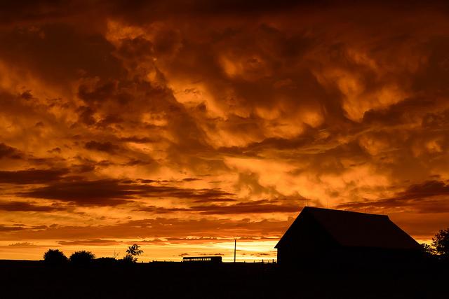 8. Orange clouds illuminate the sky during  sundown.