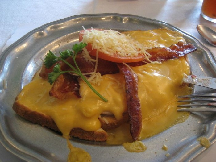 16. The Kentucky Hot Brown has turkey, bacon, tomato, and a creamy cheese sauce over toast, which makes a delicious combination.
