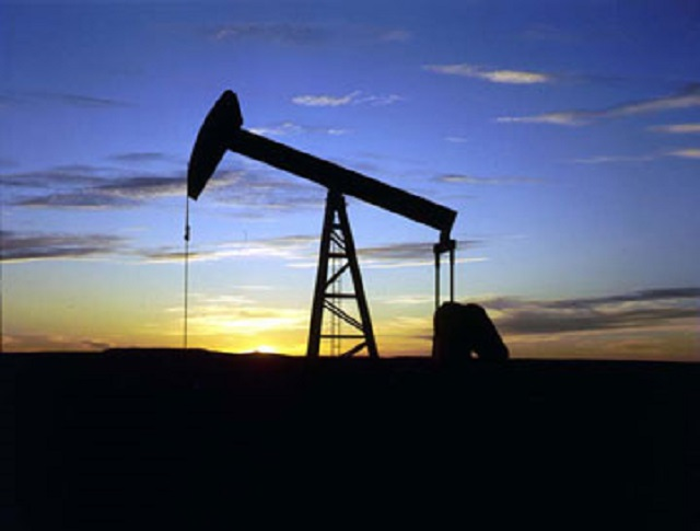 12. An oil well at sunset
