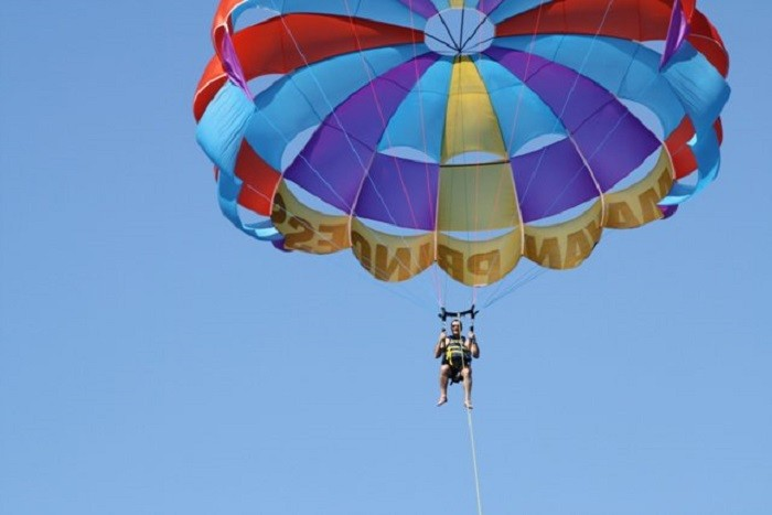 11. While on your beach vacation, try out parasailing.
