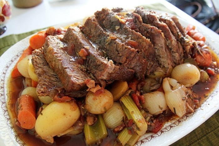 5. A pot roast with vegetables cooked in a crock pot is a nice meal for family or friends. We usually end up turning the broth from the seasoned meat and veges into a stew. It's a quick cheat on burgoo.