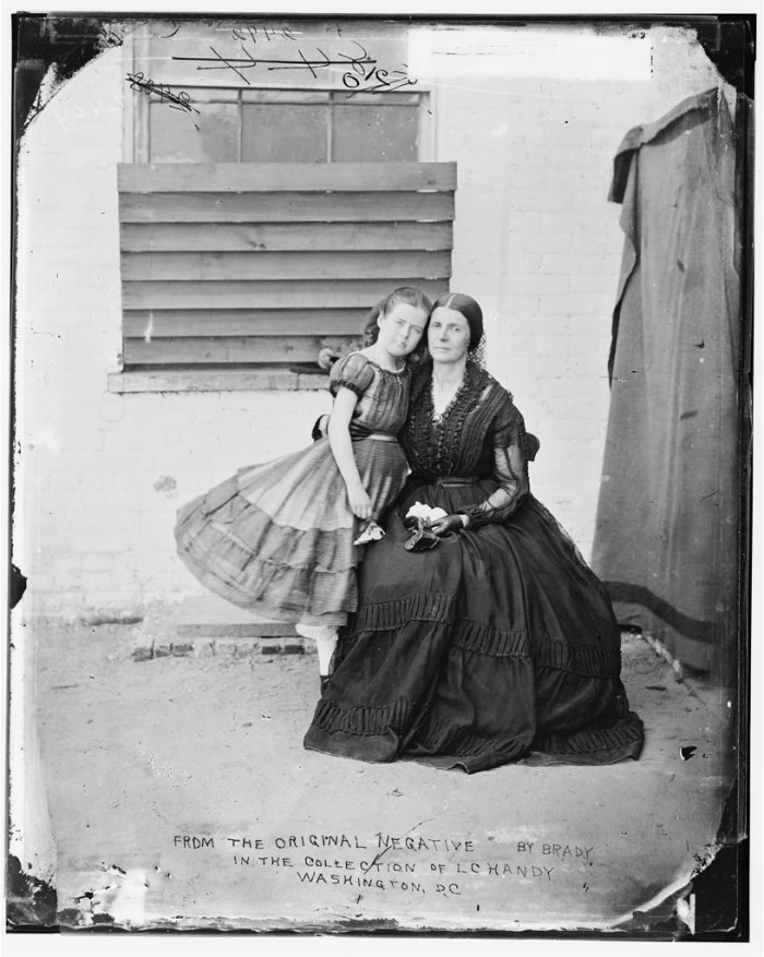 "19. Convicted spy Rose O'Neal Greenhow and her daughter, ""Little Rose"", at the Old Capital Prison in Washington, D.C. before she was deported to Richmond, 1862"