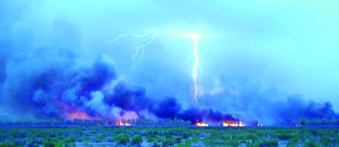 8. A wildfire caused by lightning is captured here.