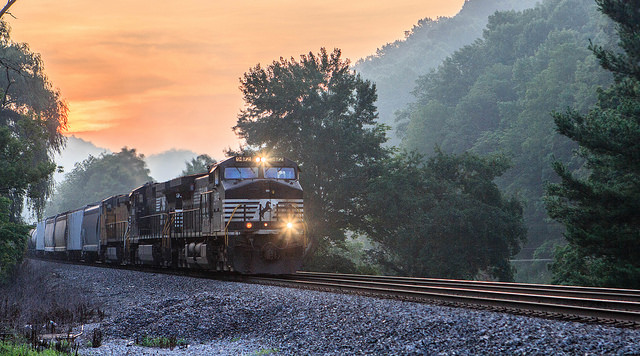 1) A train coming through Ada, West Virginia during the sunrise.
