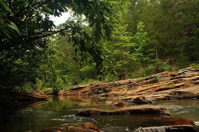 21. Big Shoal Creek: This swimming hole is at the foot of a rock cliff. The cliff is 40-50 feet high with a hole in it that is said to be about the size of a half bushel.