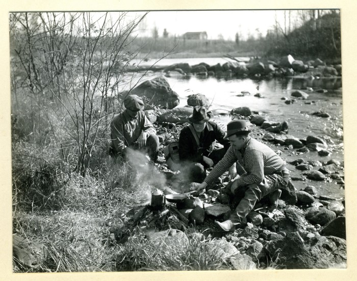 6. Men sitting at a campfire along Turtle Creek in 1936.