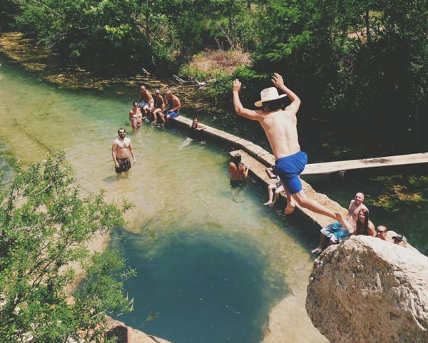 13) Dive into the depths of 200 ft deep caverns at Jacob's Well in Wimberley! (Not for the faint of heart)