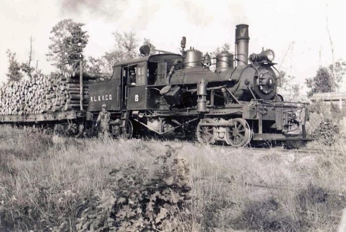 4. Train carrying lumber through Mercer, Wisconsin--circa 1937.
