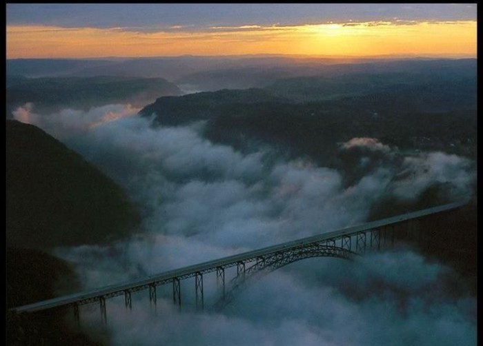 10) Nothing is more beautiful than the sunrise   behind the New River Gorge Bridge near Fayetteville, West Virginia.