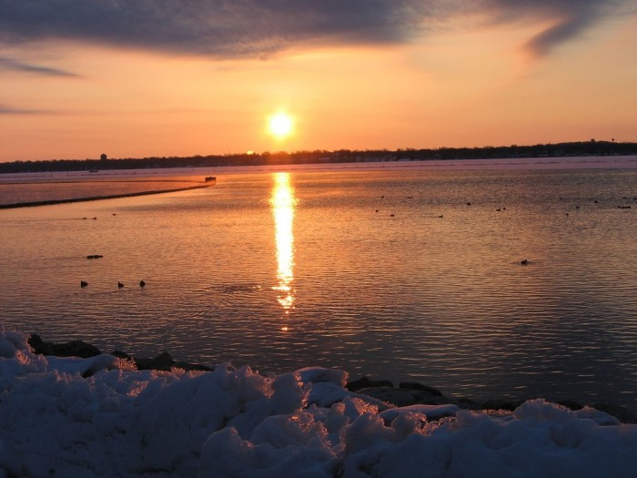 9. I really appreciate the juxtaposition of snow and sunrise over Lake Monona (Madison).