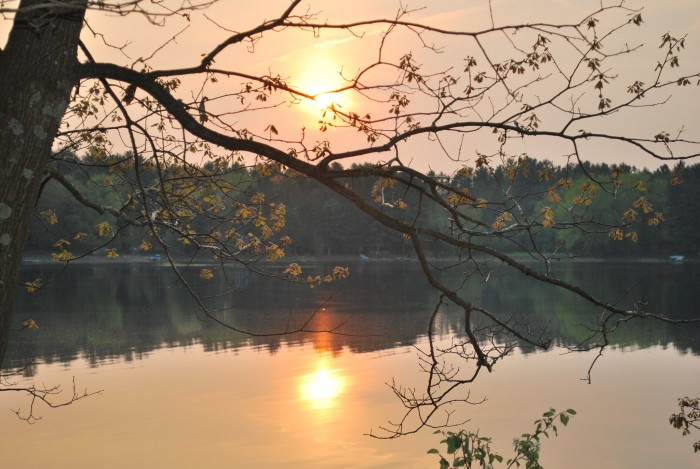 12. The sunset reflects in the lake situated in Amherst Junction.