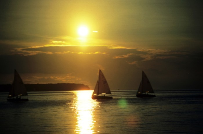 5. Lucky people are on a sailboat as the sun sets in Fish Creek.