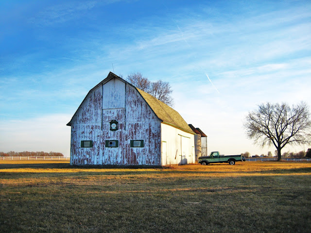 13. Looking more like a post card, this large barn and the pick-up truck create a perfect scene.