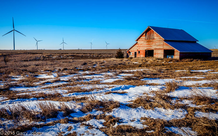 1. Old Red Barn With a Wind Farm