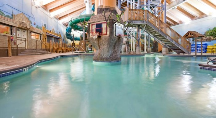 8 Wild Woods Waterpark in Elk River is full of fun water games like an old-fashioned log walk!