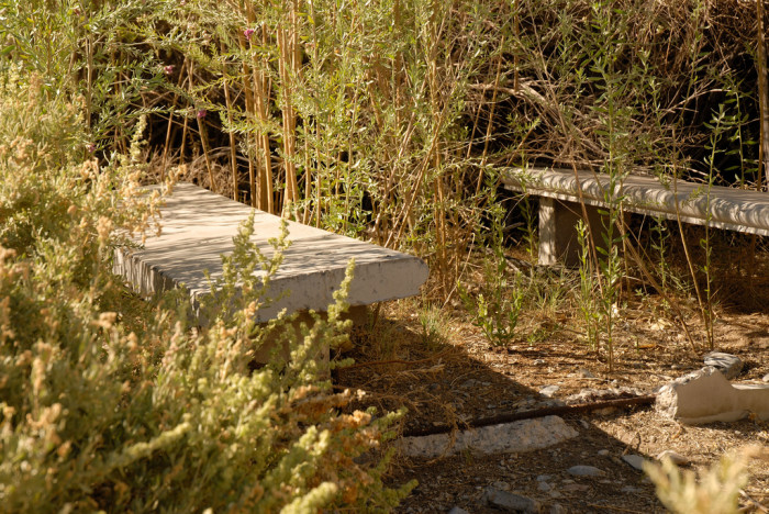 1. An abandoned picnic table located within the Desert National Wildlife Refuge.