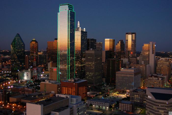 12) The Dallas skyscrapers illuminate the peaceful night sky.