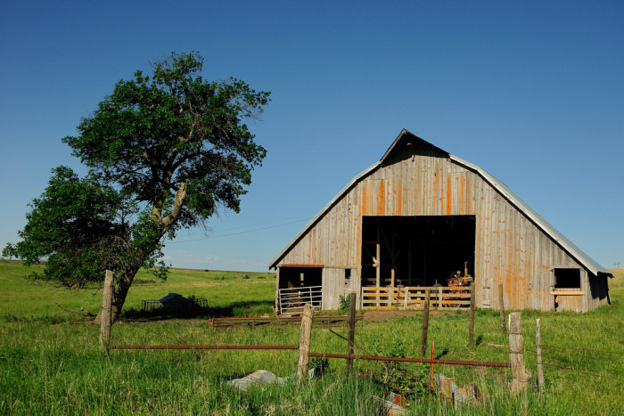 10. A Sturdy Old Barn With a Tractor Inside