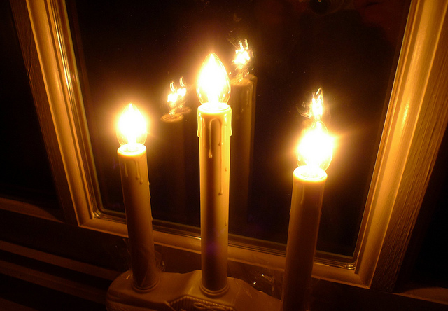 10. Put electric candles in the window of your house.