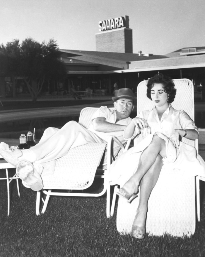 10. Elizabeth Taylor and her husband Michael Wilding at the Sahara, 1956